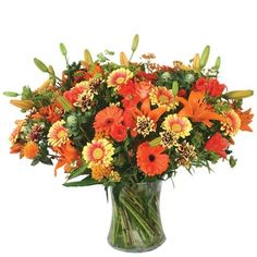 Vase with 10 Orange Lilies , 10 Orange Gerberas , 10 Yellow Gerberas & Crysanthimums