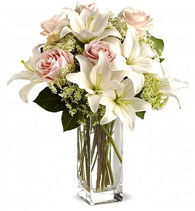 Vase with 5 Stems of White Lilies , 6 Stems of Off White Roses with Lady Lase or Gypsophelia